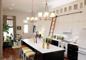 Farmhouse modern kitchen with dark cabinetry by Waypoint