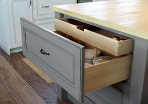 Drawer pulled out in gray with dark hardware