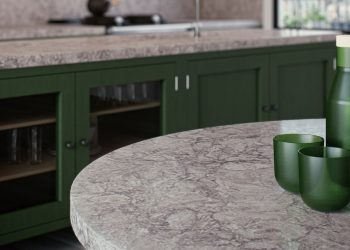 Green kitchen with gray countertops