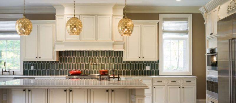 Elegant pearl glazed cabinets with green backsplash.