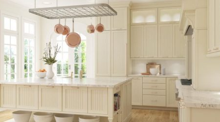 Country style kitchen with off white cabinets.